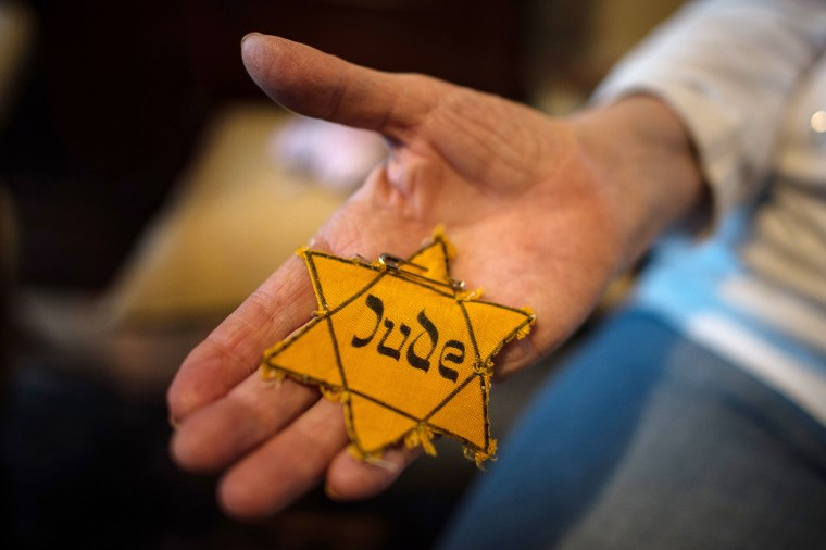 Image: A Holocaust survivor shows her star of David in Duesseldorf, Germany on Jan., 21, 2015.