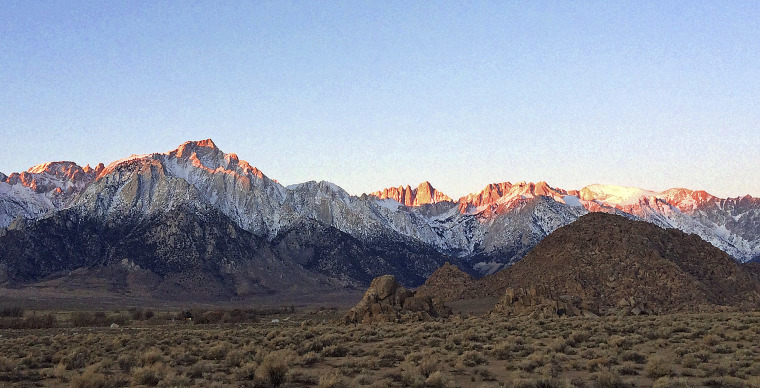 Image: The eastern Sierra Nevada, with Mt. Whitney, the largest of three pinnacles at center, near Lone Pine, Calif. A hiker fell to his death at nearby Mount Russell on Monday, May 31, 2021.