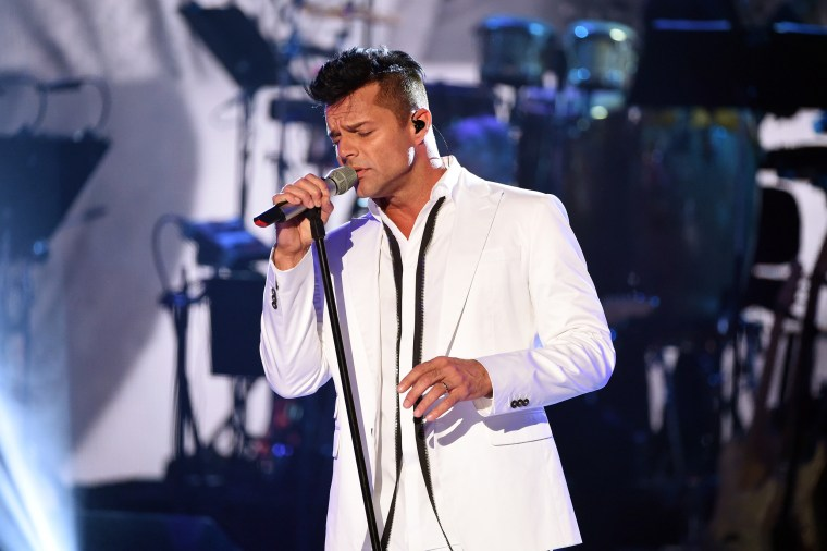 """Image: Ricky Martin performs during \""""One Voice: Somos Live! A Concert For Disaster Relief\"""" on Oct. 14, 2017, in Los Angeles."""
