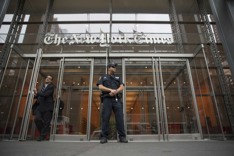 Image: A police officer stands outside The New York Times building in New York.