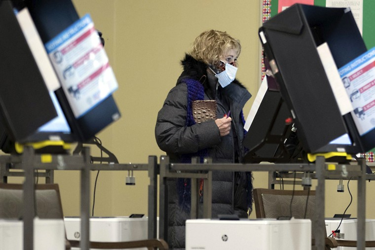 Image: A woman votes after polls opened in Georgia's Senate runoff elections on Jan. 5, 2021, in Acworth, Ga.