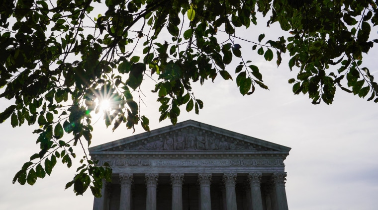 The sun rises behind the U.S. Supreme Court on June 1, 2021.