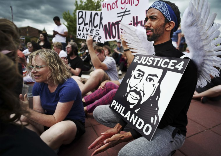 Protesters gathered at Silver Lake Village Shopping Center during a demonstration against the acquittal of Officer Jeronimo Yanez, was found not guilty of manslaughter for shooting Philando Castile during a traffic stop, on June 18, 2017, in St. Anthony,