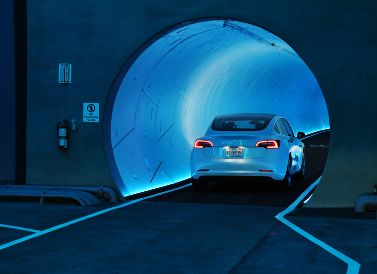 A Tesla car enters a tunnel during a media preview of the Las Vegas Convention Center Loop on April 9, 2021.