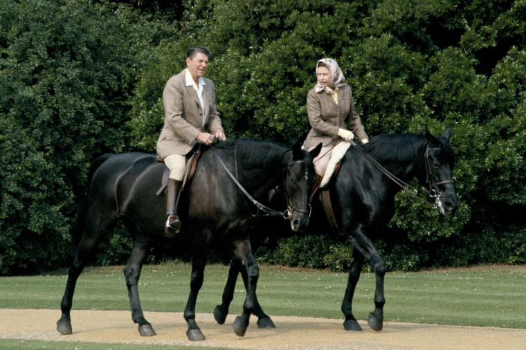 Queen Elizabeth II riding in the grounds of Windsor Castle with President Ronald Reagan, during his state visit to the UK, June 8, 1982. She is riding her horse 'Burmese' and he is mounted on 'Centennial', both gifts to the Queen from the Canadian Mounted Police.