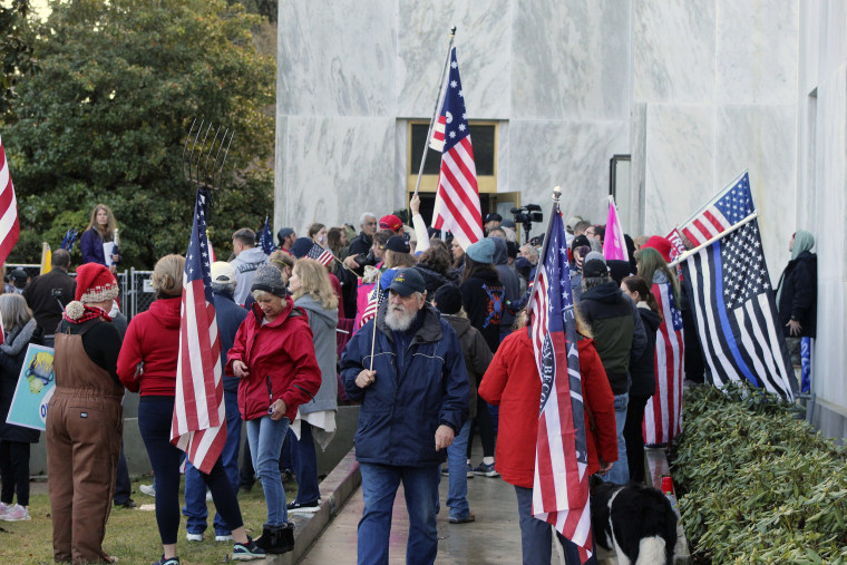 Image: Pro-Trump and anti-mask demonstrators hold a rally outside the Oregon State Capitol on Monday, Dec. 21, 2020, as legislators meet for an emergency session.