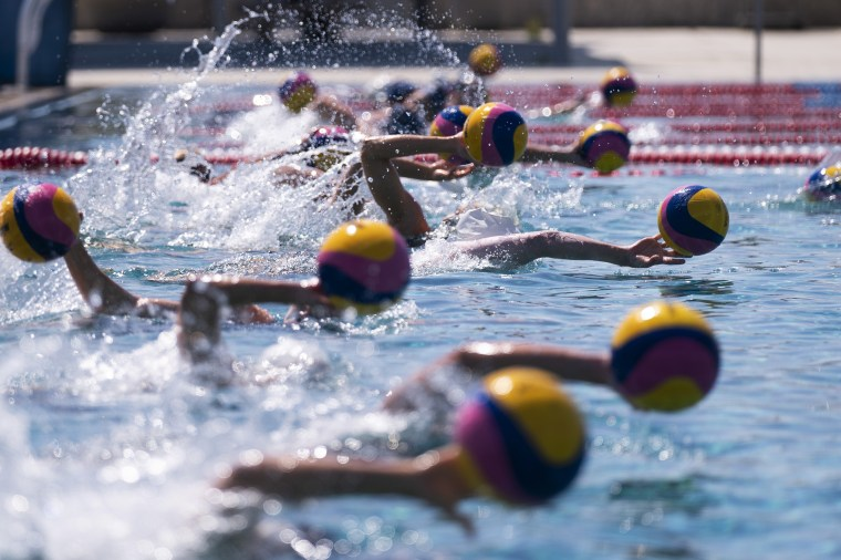 Members of U.S. women's water polo team train at MWR Aquatic Training Center in Los Alamitos, Calif., on April 27, 2021.