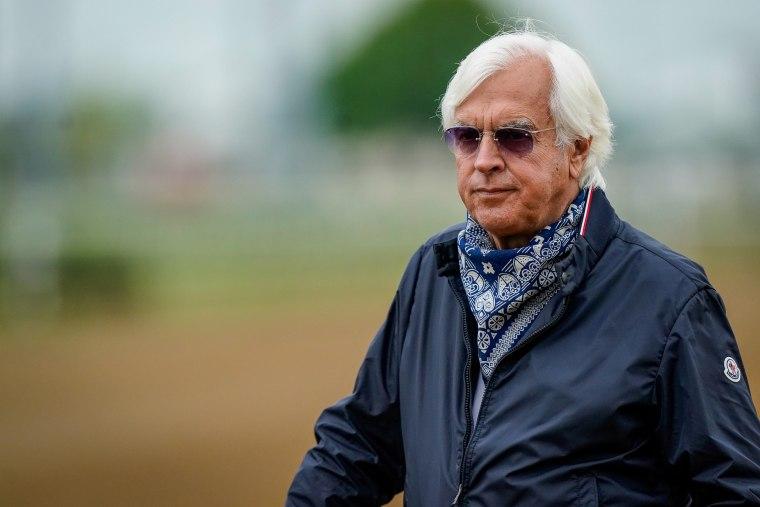 Bob Baffert, trainer of Kentucky Derby winner Medina Spirit, stands near the track at Churchill Downs in Louisville, Ky., on April 28, 2021.