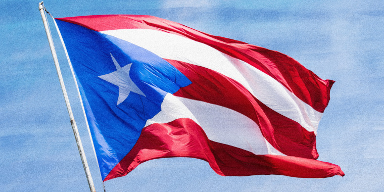 Photo illustration: A Puerto Rican flag waving in the sky.