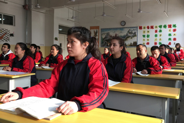 Image: Residents at the Kashgar city vocational educational training center