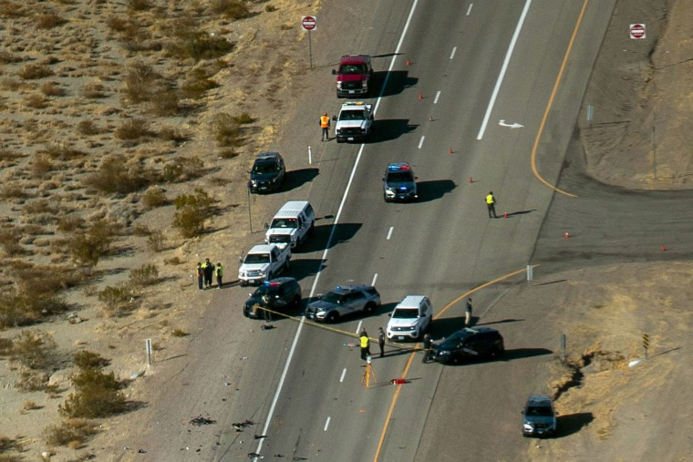 Image: Nevada Highway Patrol investigate the scene of a fatal crash involving multiple bicyclists and a box truck along U.S. Highway 95 southbound near Searchlight, Nev.
