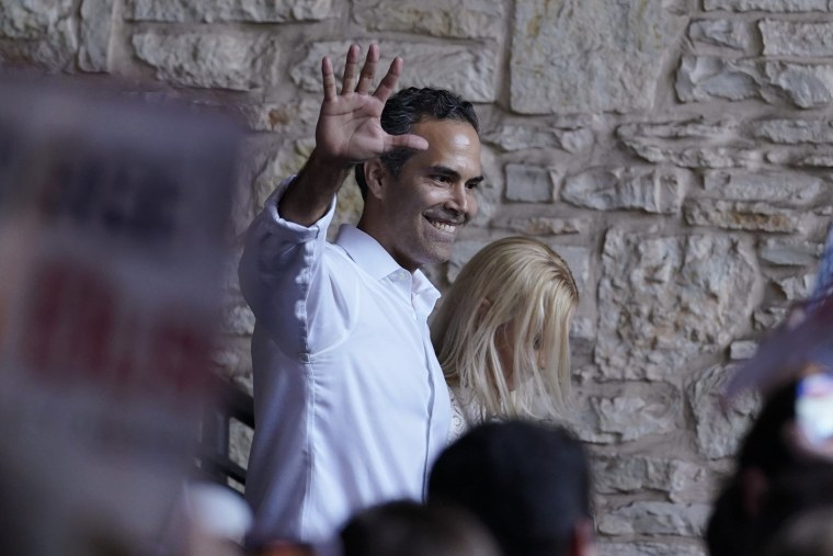 Image: George P. Bush arrives for a kick-off rally with his wife Amanda to announced he will run for Texas Attorney General on June 2, 2021, in Austin, Texas