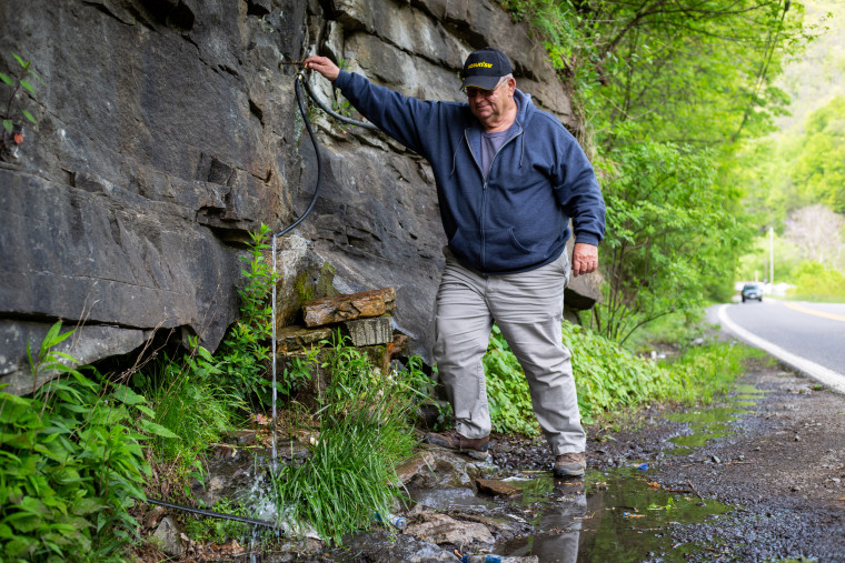 All the water's bad': In McDowell County, you have to get creative to find safe drinking water 210610-west-virginia-water-hose-jm-1526