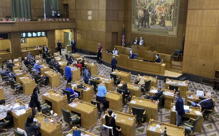 Image: The Oregon House of Representatives get set to open a session on the evening of Thursday, June 10, 2021, to consider expelling member Rep. Mike Nearman for letting violent protesters into the Oregon Capitol in December.