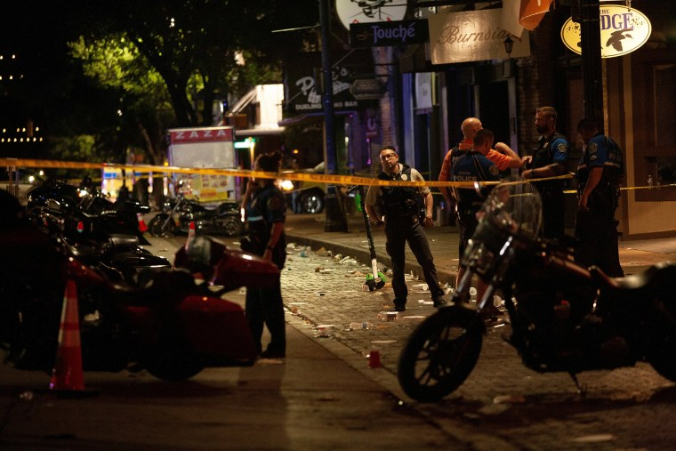 Image: Police investigate the scene of a mass shooting in the Sixth Street entertainment district area of Austin,