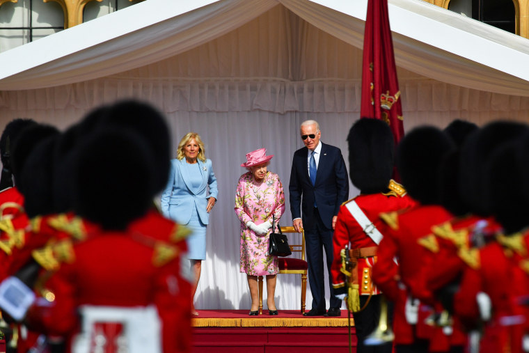President Joe Biden, Jill Biden and Britain's Queen Elizabeth stand in front of members of the Royal Guard at Windsor Castle in Windsor, Britain, on June 13, 2021.