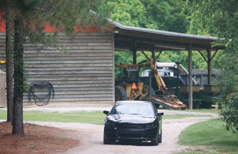 A vehicle sits in the driveway of a home on June 8, 2021, in rural Colleton County, near Islandton, S.C.