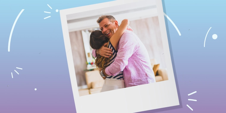 Woman hugging a man in a living room