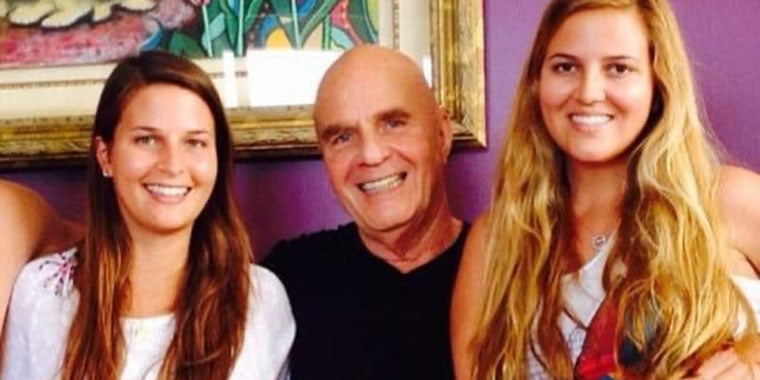 Wayne Dyer shares a happy moment with his daughters Saje, left, and Serena.