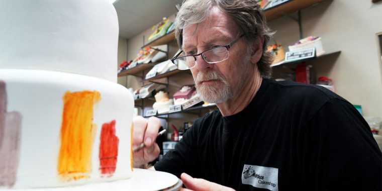 Baker Jack Phillips decorates a cake in his Masterpiece Cakeshop in Lakewood