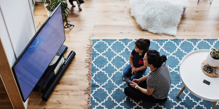 mother and daughter watching tv in living room. See the best TV brands to try in 2021. Shop top TV brands including the Samsung Q90A QLED TV, LG CX OLED TV, TCL Class 5 Series and more.