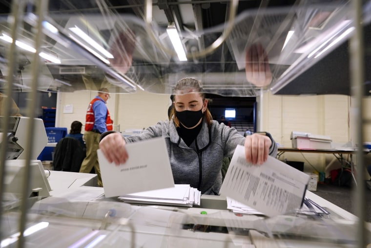 Image: Kristina Sladek, an election worker in Chester County, Pa., opens mail-in and absentee ballots on Election Day.