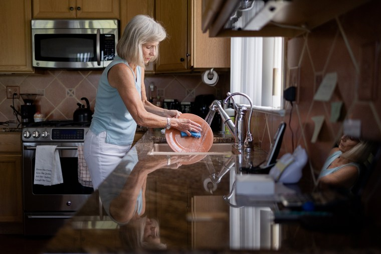 Image: Margo Woodacre washes dishes at home in Landenberg, Pa., on June 10, 2021.