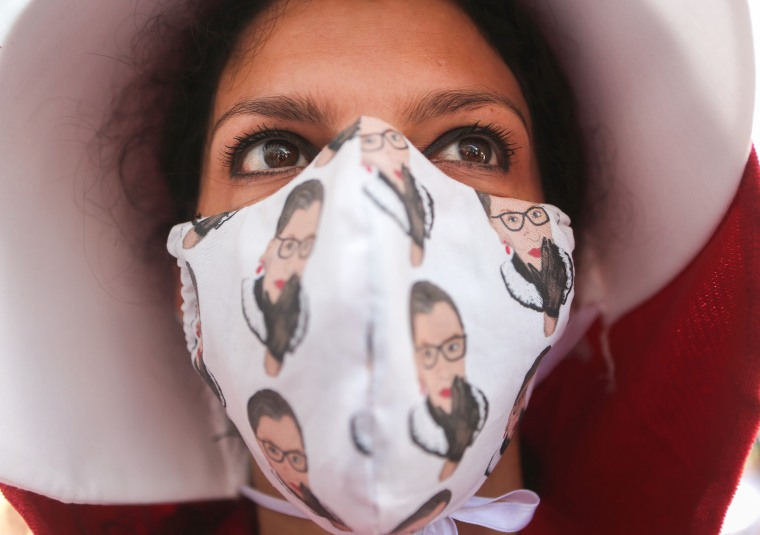 Image: A protester wears a face mask depicting Ruth Bader Ginsburg during a Women's March on Oct. 17, 2020 in Los Angeles.