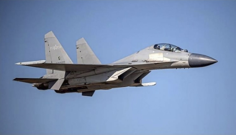 Image: A Chinese PLA J-16 fighter jet flies in an undisclosed location