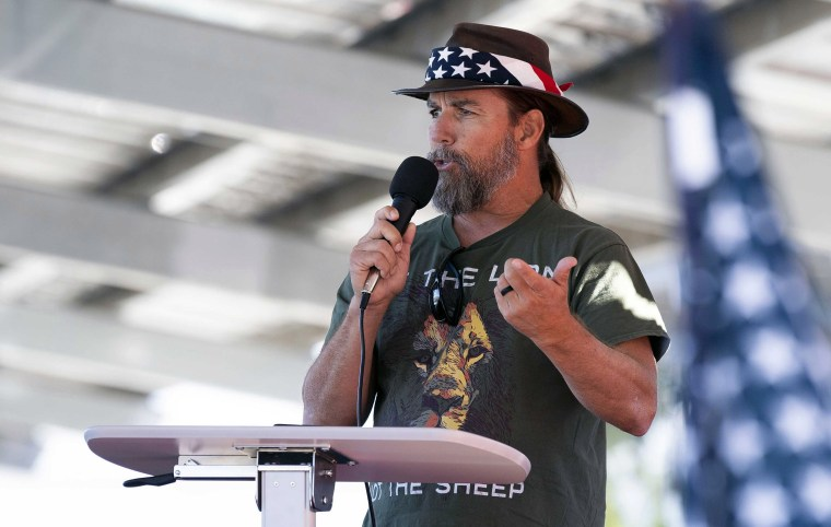 Image: Alan Hostetter speaks during a pro-Trump election integrity rally he organized at the Orange County Registrar of Voters offices in Santa Ana, Calif.