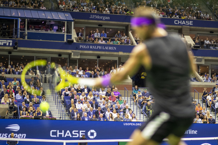 Spectators watch the men's singles final between Rafael Nadal and Daniil Medvedev at the U.S. Open Tennis Championships on Sept. 8, 2019, in New York.