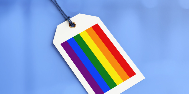 Photo illustration: A shopping tag with the pride flag colors.
