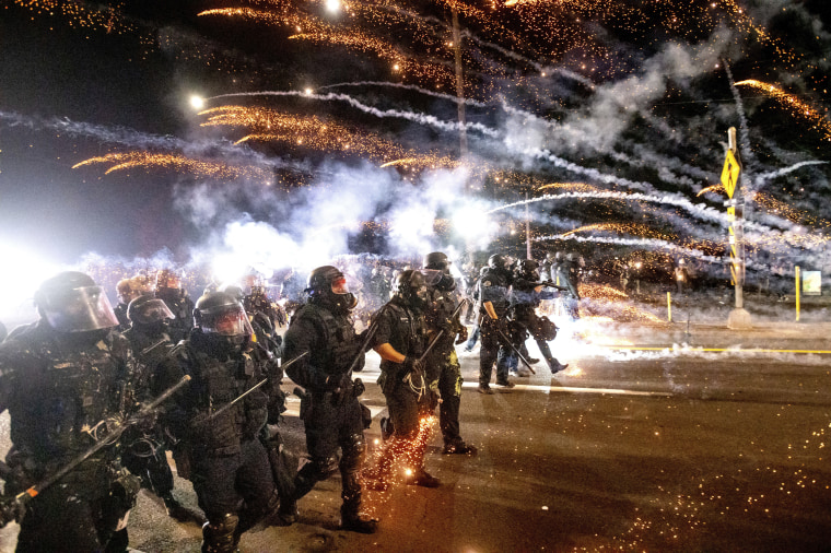 Police use chemical irritants and crowd control munitions to disperse protesters during a demonstration in Portland, Ore., on Sept. 5, 2020.