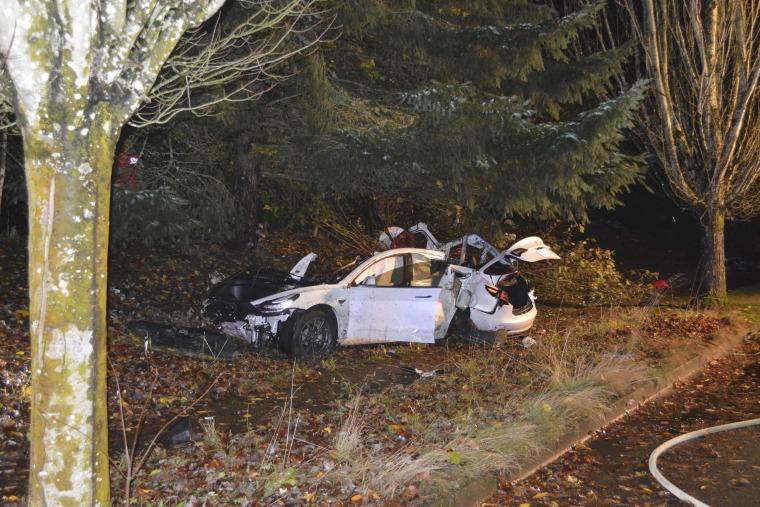 The scene where an Oregon man crashed a Tesla while going about 100 mph, destroying the vehicle, a power pole and starting a fire when some of the hundreds of batteries from the vehicle broke windows and landed in residences in Corvallis, Ore., in November 2020.