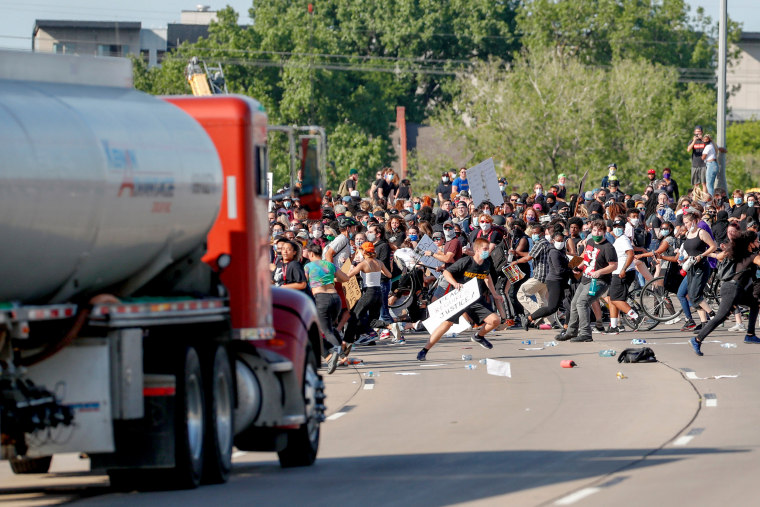 Image: A tanker truck drives into thousands of protesters marching on 35W north bound highway during a protest against the death in Minneapolis police custody of George Floyd, in Minneapolis on May 31, 2020.