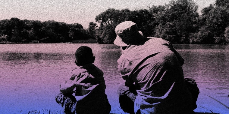 Image: Father and son looking at a lake.