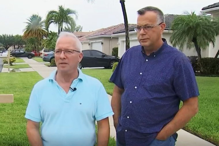 Bob Plominski and Mike Ferrari say they are facing steep fines for displaying the flag in the front yard of their home.