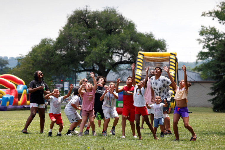 Image: Children prepare to catch free t-shirts at the Juneteenth celebration at Memorial Park in Kingsport