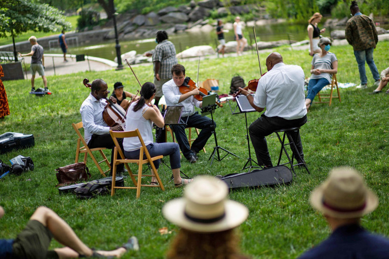Musicians play classical music in a park during the Juneteenth celebration in New York's Harlem neighborhood.