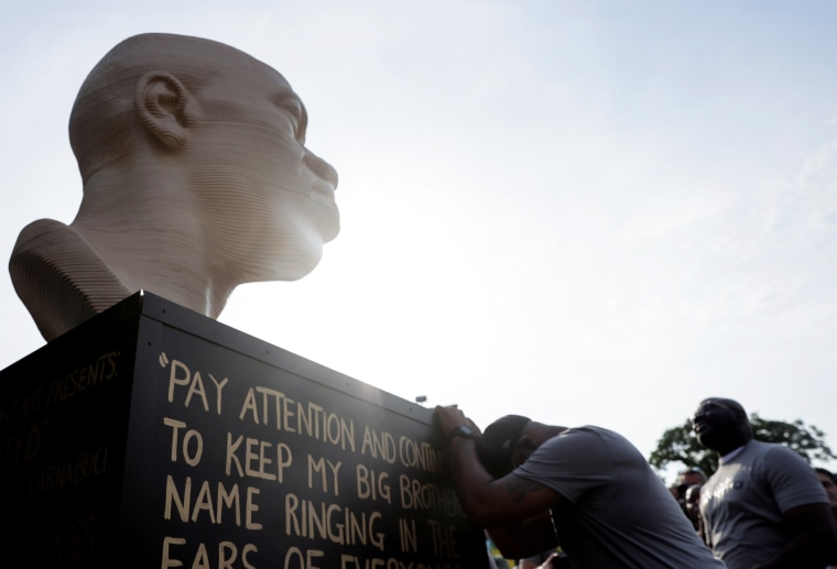 Terrence Floyd, George Floyd's brother, reacts during the unveiling of a new statue of his brother to commemorate Juneteenth in Brooklyn, N.Y., on June 19, 2021.