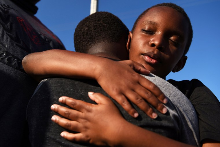 Brothers Brody and Braeden Maxey share a hug during a reenactment to celebrate Juneteenth in Galveston, Texas, on June 19, 2021.