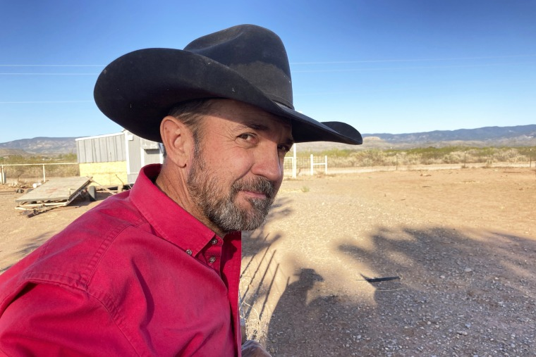 Otero County Commissioner Couy Griffin, the founder of Cowboys for Trump, takes in the view from his ranch in Tularosa, N.M., on May 12, 2021.