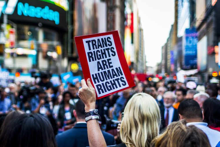 Protesters gather in New York on July 26, 2017, after then-President Donald Trump announced in a series of tweets a ban on transgender people serving in the military.