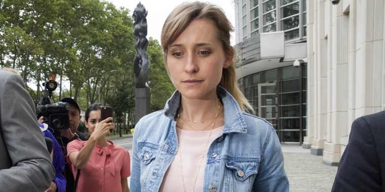 Actress Allison Mack, center, leaves Federal court, Wednesday, July 25, 2018, in the Brooklyn borough of New York.