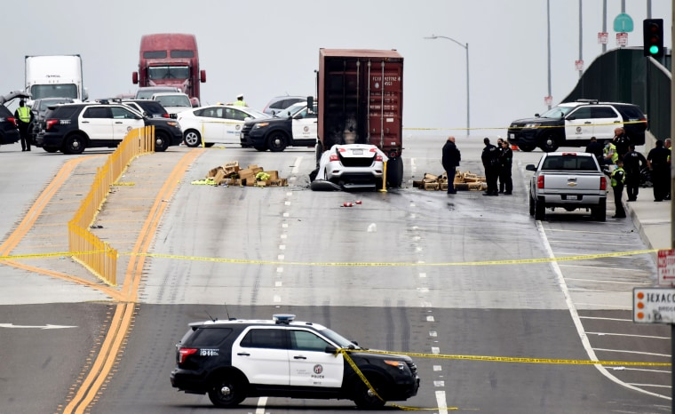 Emergency personnel respond to the scene of a fatal car crash in Long Beach, Calif., on June 25, 2020.