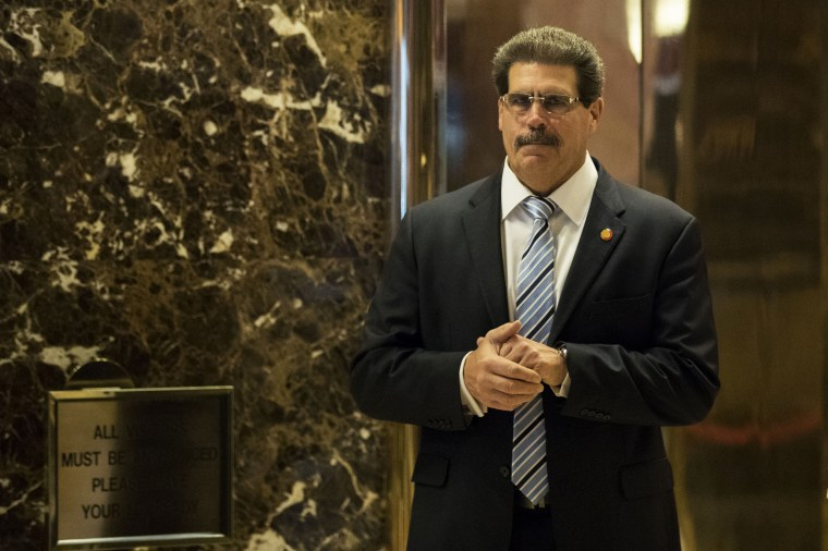 Matthew Calamari stands in the lobby at Trump Tower on Jan. 12, 2017, in New York.