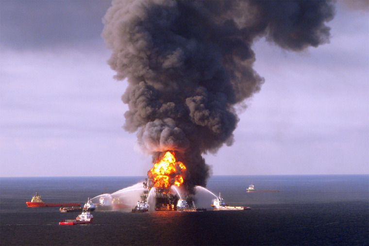 Image: Fire boat response crews as they battle the blazing remnants of the off shore oil rig Deepwater Horizon, on April 21, 2010.