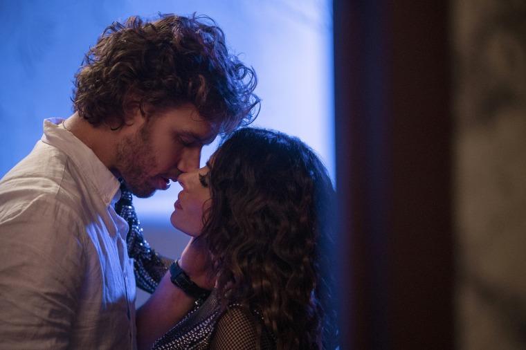 "Image: Adam Demos as Brad Simon and Sarah Shahi as Billie Connelly in, \""Sex/Life.\"""