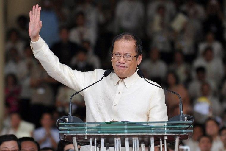 Image: Philippine President Benigno Aquino waving to the crowd after delivering his inaugural speech at the Quirino Grandstand in Manila