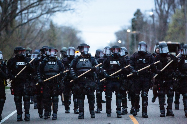 Minneapolis police officers stand in line during a protest in Brooklyn Center, Minneapolis, Minn., on April 11,2021.